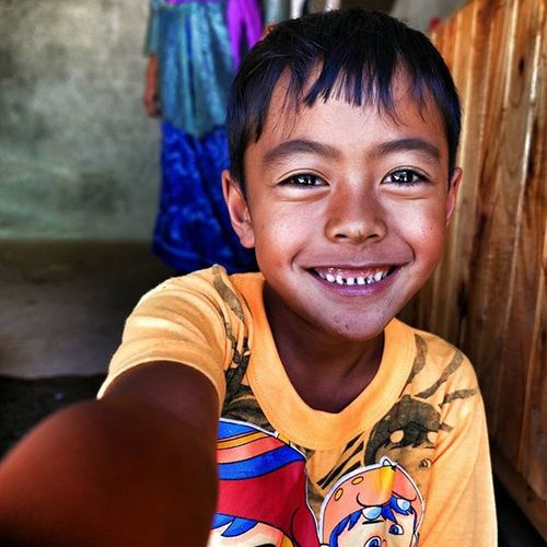 This Young Buddy Abused my Camera and took a happy selfie. 💓☺🌞🌊🏄 kintamani coffee farm ecofarm kid boy indonesia smile fun asia traveling world vsco instagood enjoy travelgram