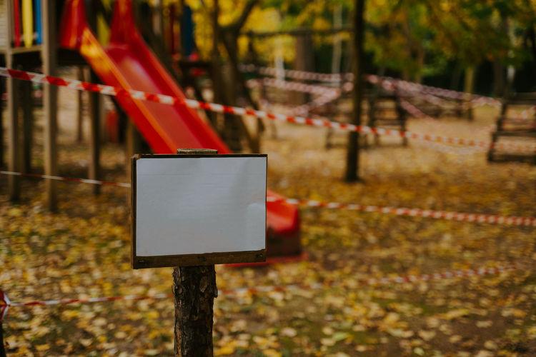 Information sign on metal fence in park