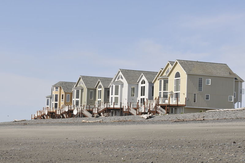 Beautiful dream houses - pastel in color - located on a beach in homer, alaska
