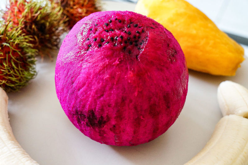 Pinky ball Fruit Dragonfruit Tropical Fruit Pink Colourful Fruit Red Close-up Purple