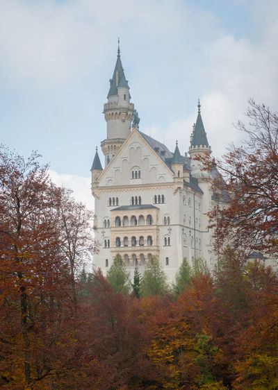 Neuschwanstein Castle with Autumn colors, Fussen, German Tree Architecture Sky Autumn Plant Built Structure Building Religion Building Exterior Change Spirituality Nature Place Of Worship Belief Tower No People The Past History Outdoors Spire