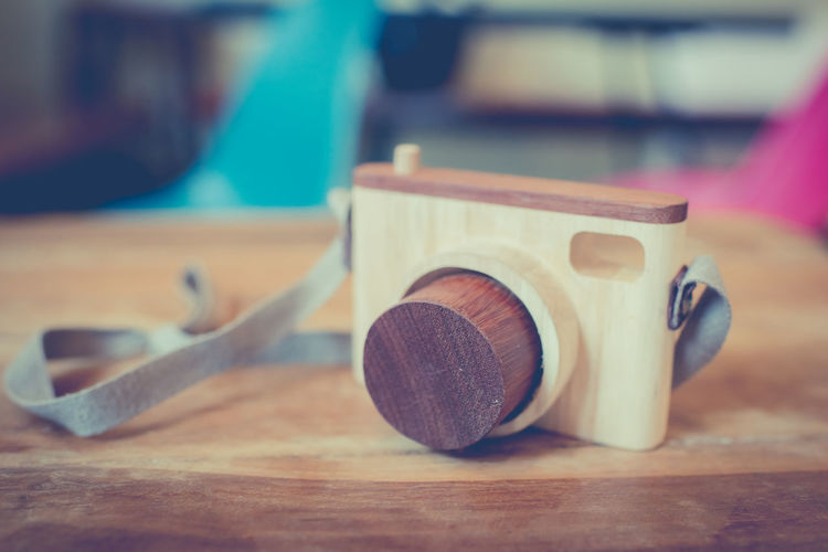 Close-up of wooden camera on table