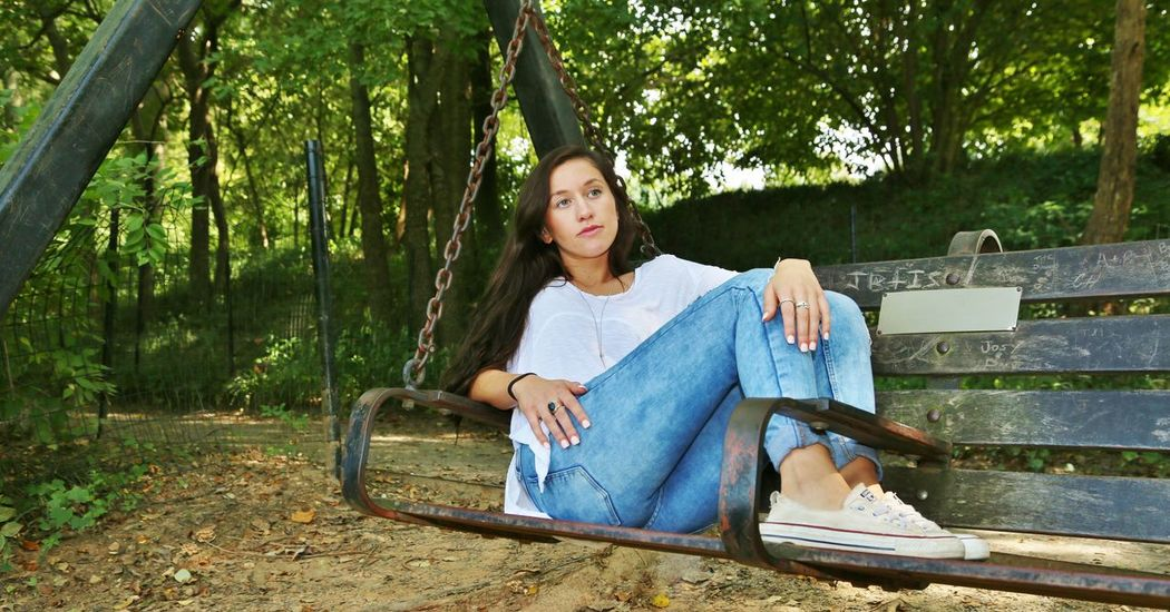 Pensive Swingset Beautiful Woman Blue Jeans Brown Hair Casual Clothing Chillaxing Day One Person One Woman Only Sitting Sneakers Staring Tree Women Wooden Swing