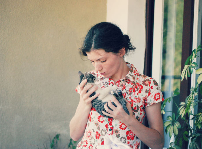 Young Woman Holding Kitten