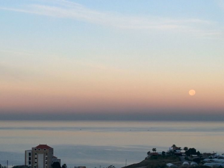 Moonsetting Moonset At Sunrise Urban Skyline Nature Beauty In Nature Byblos,Lebanon Reflection Sea Beach Silhouette Water Nature Silvery Sky Tranquil Scene Landscape Day Horizon Over Water Dramatic Sky Tranquility Perspectives On Nature Scenics From My Balcony. @the Easter Mediterranean Coast