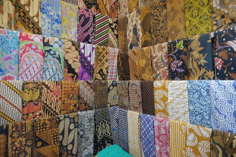 Batik Multi Colored Choice Variation Backgrounds Full Frame For Sale Pattern Large Group Of Objects Small Business Market Stall Design Hanging Collection Art And Craft No People Arrangement Retail  Textile Market Business The Traveler - 2018 EyeEm Awards