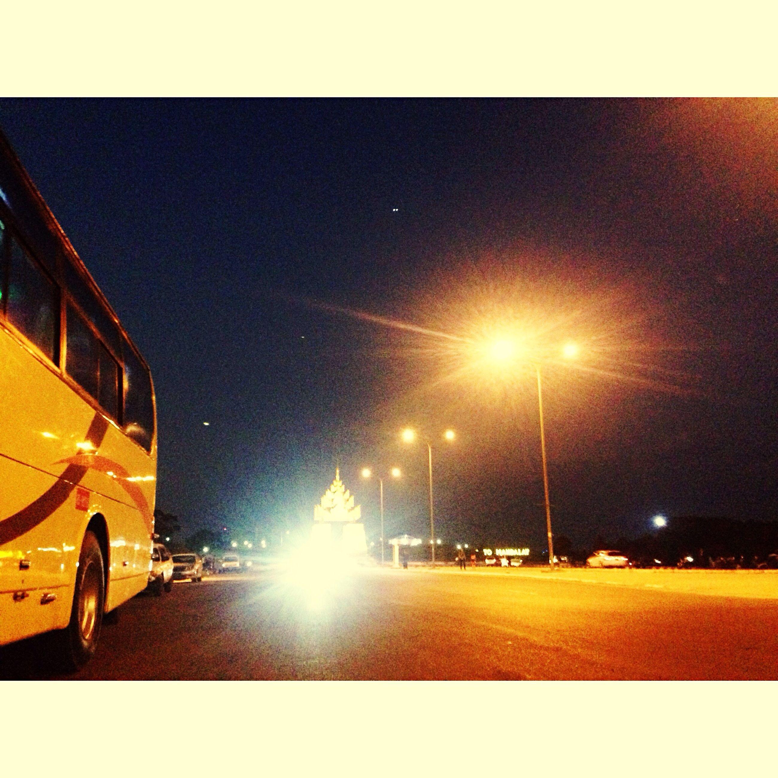 transportation, car, land vehicle, lens flare, street light, mode of transport, illuminated, night, sky, road, outdoors, tree, sunset, no people, architecture
