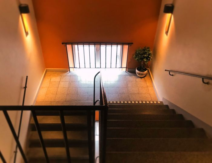 Architecture Indoors  No People Railing Staircase Wall - Building Feature Built Structure Steps And Staircases Illuminated Orange Color Lighting Equipment Ceiling Direction Window Directly Below Metal Building My Best Photo