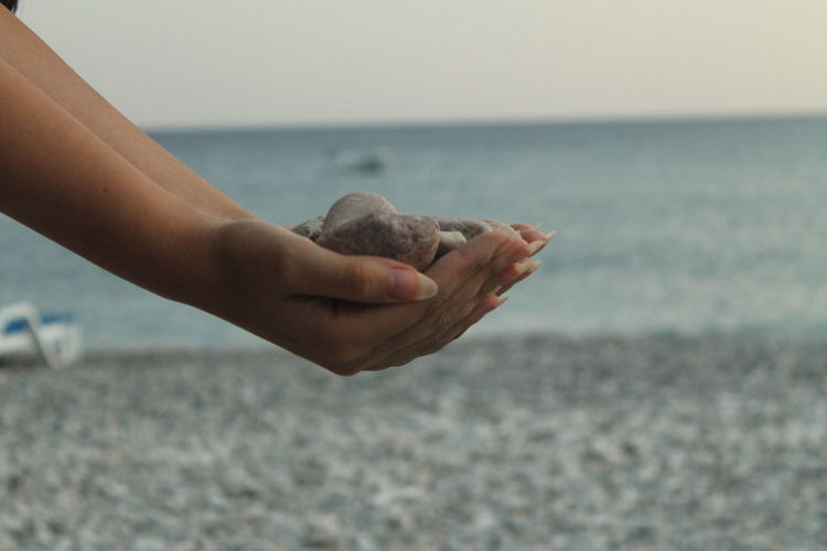 Special Pebble Alone In The Beach Pebble Beach Focus On Hand Gravel Hand Nature Pebble Pebbles Sea