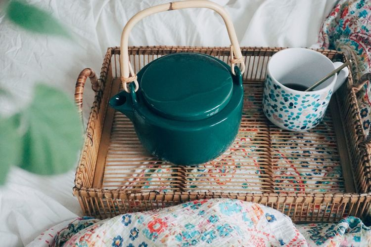 High angle view of wicker basket on bed at home