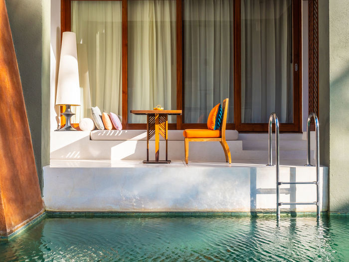 Chairs and tables in swimming pool
