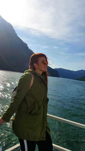 Adult Adults Only One Person People Mountain Only Women Outdoors One Woman Only Day Standing Vacations Young Adult Nature Sky One Young Woman Only Young Women Ginger Tree Nature Water Lake Side View Vacations Travel Destinations Cold Temperature EyeEm Ready   AI Now EyeEmNewHere