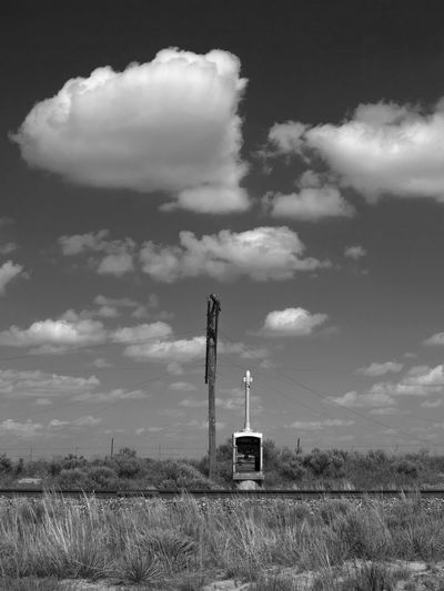Sentinels Atmosphere Black And White Cloud Cloud - Sky High Plains Lonely No People Outdoors Prairie Railroad Railroad Switch Boxes Railroad Telegraph Sky Telegraph