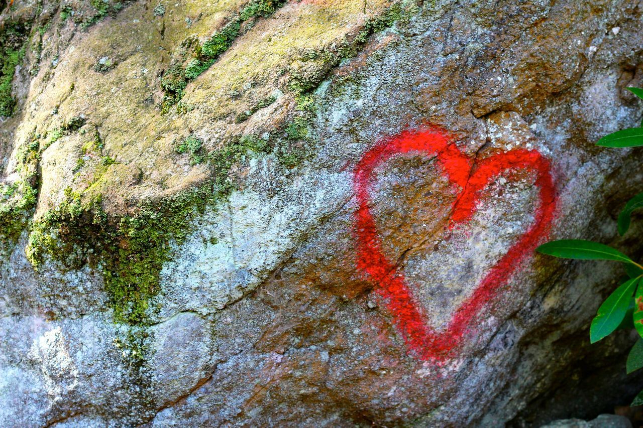 Close-Up Of Red Heart Shape On Rock