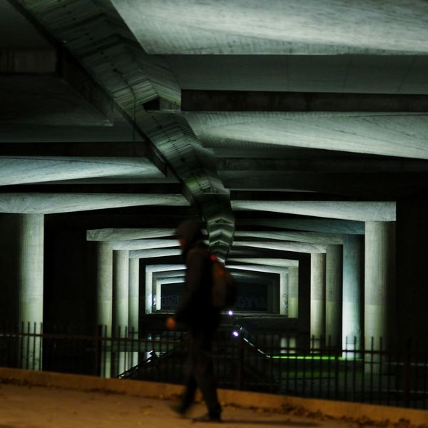One Person One Man Only Walking People Architecture Built Structure City Rotterdam City Spaces Between Shadows & Lights Night Street Streetphotography Backgrounds Under The Bridge