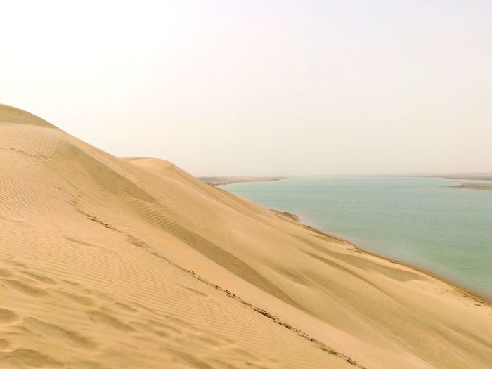 EyeEm Best Shots EyeEmNewHere EyeEm Selects Sand Dune Clear Sky Sea Desert Beach Sand Arid Climate Sunset Water Summer