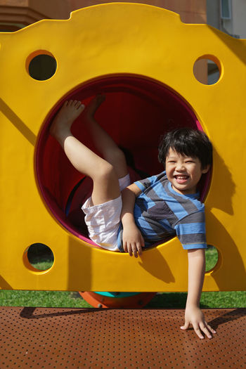 Boy playing in playground