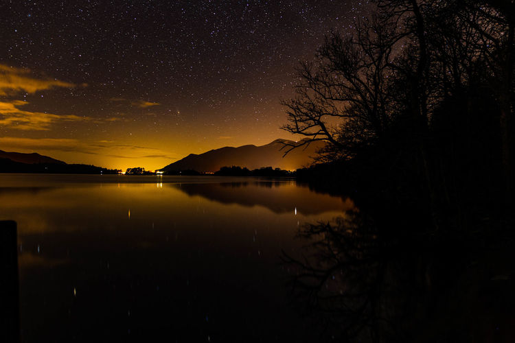 Derwent water at night from ashness jetty with reflections on the lake