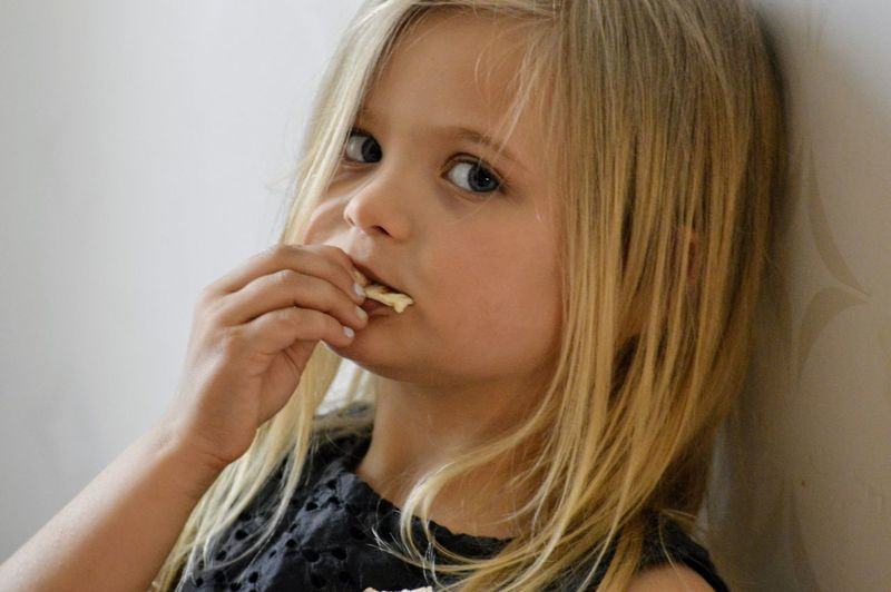 Domestic Life Snack Time! Eating Blond Hair Portrait Child Childhood Headshot Girls Looking At Camera Beauty Human Face Human Eye Thoughtful Blue Eyes Eye Color Eyebrow Thinking Natural Beauty Inner Power Focus On The Story The Portraitist - 2018 EyeEm Awards My Best Photo