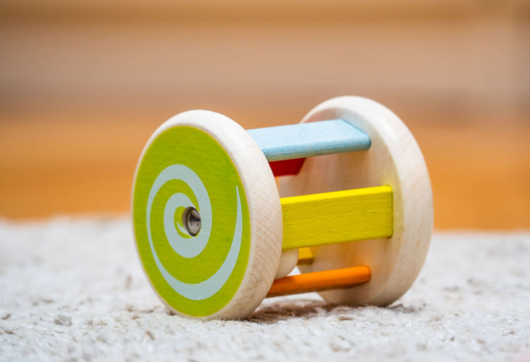 Close-up of yellow toy on sand
