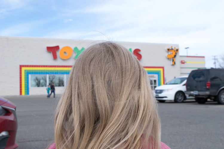 Parking Lot Toys R Us Blond Hair Building Exterior Built Structure Child Childhood Close-up Day Focus On Foreground Headshot History Kid One Person Outdoors People Real People Rear View Retail  Retail Store Sky Store Front Toy ToysRuskid Toysrus Toystore