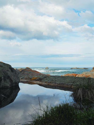 Rock pool reflection at the beach Water Sea Tranquility Beauty In Nature Idyllic Cloud - Sky Reflection Seascape Nature Majestic Cloud Day Olympus OM-D E-M5 Mk.II Bicheno Eyeem Australia