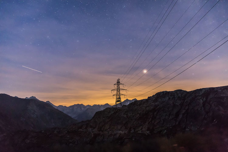 Power pylon on a swiss mountain Night Nature Sky Space Outdoors Electricity  Mountain Infinity Astronomy Alps Astrology Beauty In Nature Electric Pole EyeEm Best Shots Power Line  Power Supply Electricity Pylon Star Field Mountain Range Power Cable Alps Switzerland Star - Space Space And Astronomy EyeEmNewHere Skyporn