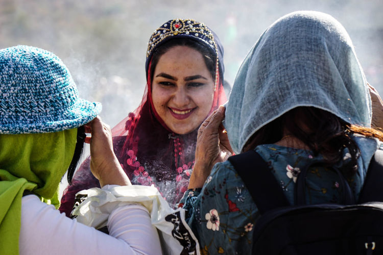 Travel Destinations Travel Photography Iran Shia Community Nomadic Zoroastrian Islamic Architecture Smiling Happiness Clothing Togetherness Adult Young Adult Women Group Of People Emotion Winter Portrait People Knit Hat Young Women Friendship Warm Clothing Scarf Outdoors