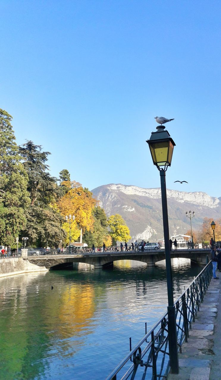 railing, street light, mountain, nature, blue, day, outdoors, tree, water, beauty in nature, no people, clear sky, built structure, architecture, scenics, sky