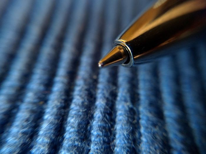 Macro shot of pen on table