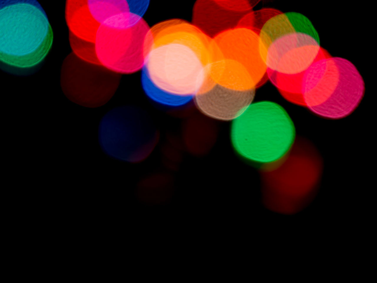 illuminated, multi colored, light effect, colorful, defocused, lighting equipment, no people, night, glowing, black background, studio shot, close-up, projection equipment, outdoors