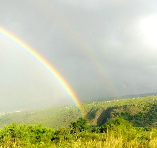 Rainbow Nature Outdoors Weather Cloud - Sky Rain Tranquility Grass Green Color Reunion Island La Réunion  Sun Landscape No People Double Rainbow