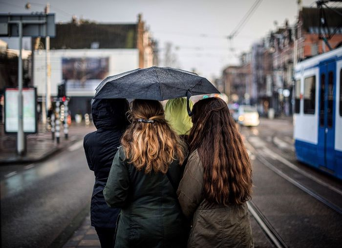 Surprise Rain storms-always bringing friends closer together Streetphotography EyeEm Best Shots Umbrella Anyoneanywhere Traveling Amsterdam Wanderlust Liveauthentic Rain Rainy Days Beautiful Place