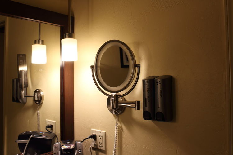 Indoors  Mirror Illuminated Bathroom Technology Lighting Equipment No People Domestic Room Home Close-up Shape Domestic Bathroom Wall - Building Feature Electric Light Light Entrance Metal Reflection Electricity  Knob