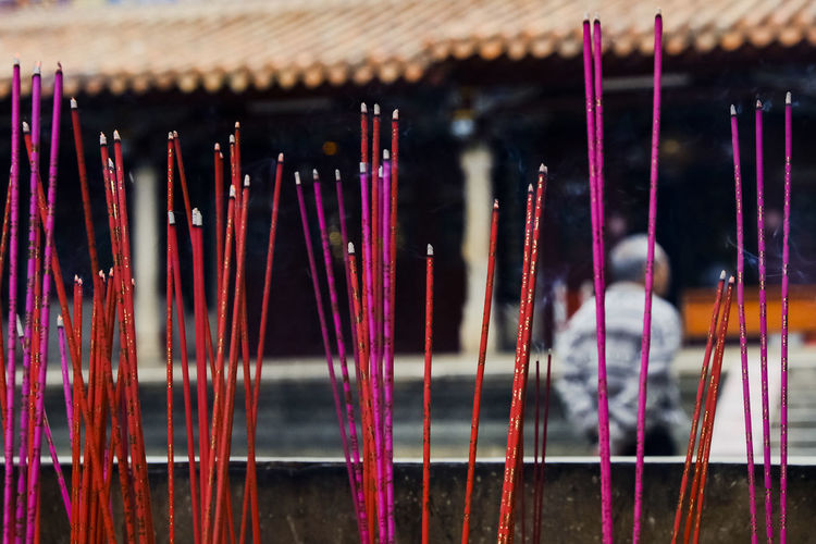 17.62° Incense Indoors  Belief Focus On Foreground Close-up No People Spirituality Religion Place Of Worship Selective Focus Building Large Group Of Objects Wood - Material Architecture Art And Craft Scented Still Life Built Structure Multi Colored