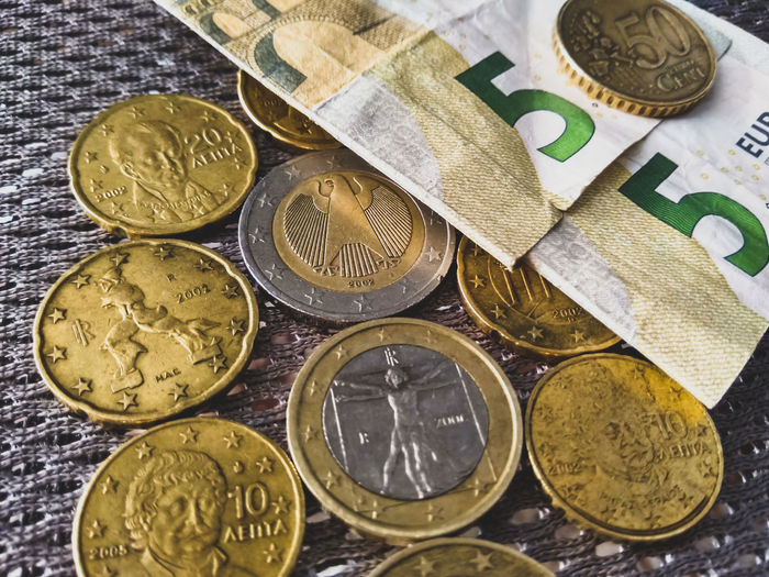 Close-up of coins in market