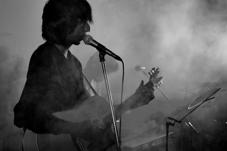 Singer performing during music concert