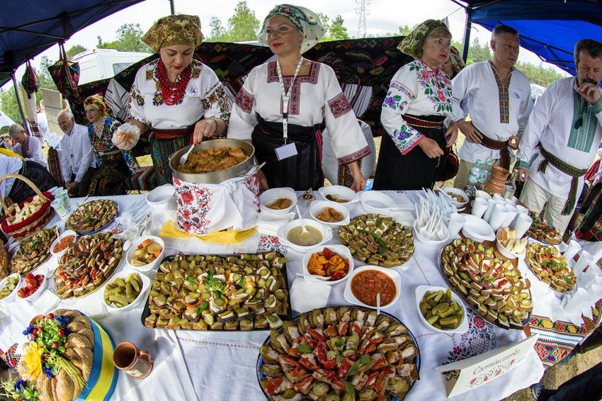 Traditional folk dishes from the area of Bukovina. Bukovina is a historic land in the Carpathians, now belongs to two states - Romania and Ukraine. Sandwiches Traditional Clothing Day Food Food And Drink Freshness Plate Real People Snacks Traditional Food Ukrainians Variation Women