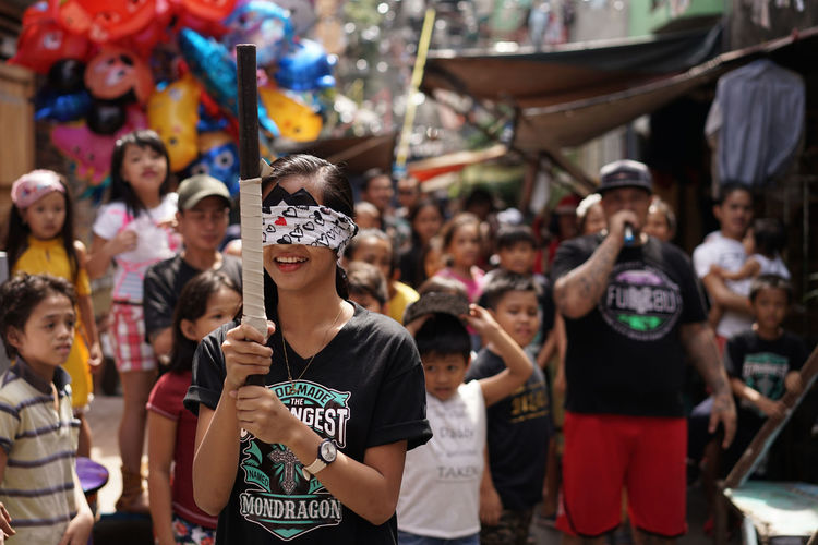 Blindfolded girl playing traditional local game ASIA Blindfolded Celebration Philippines Blindfold Crowd Enjoyment Fiesta Game Girl Large Group Of People Leisure Activity Lifestyles Real People Togetherness Women Love Is Love The Photojournalist - 2018 EyeEm Awards