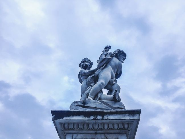 Cloud - Sky Sculpture Art And Craft Market Marketplace Human Representation Sky Creativity Male Likeness Low Angle View Outdoors Fine Art Statue No People Day Pedestal Architecture