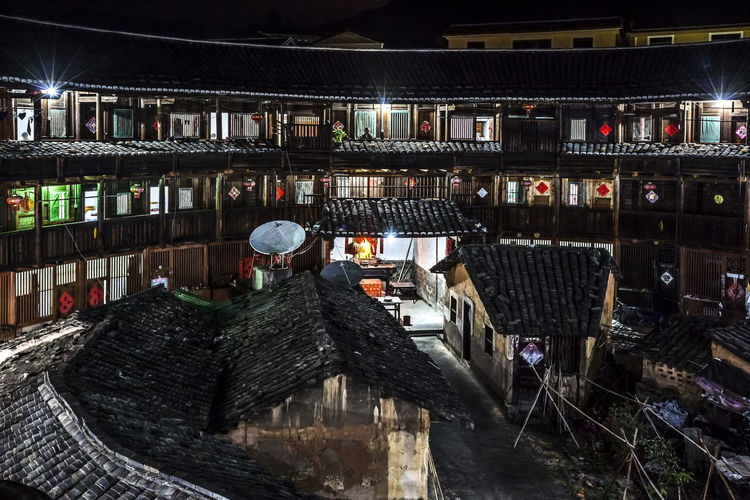 Tulou Tulou is the most extraordinary type of Chinese rural dwellings of the Hakka and others in the mountainous areas in southeastern Fujian, China. HUAWEI Photo Award: After Dark Architecture Built Structure Hakka Illuminated Night Night View No People Rural Dwellings