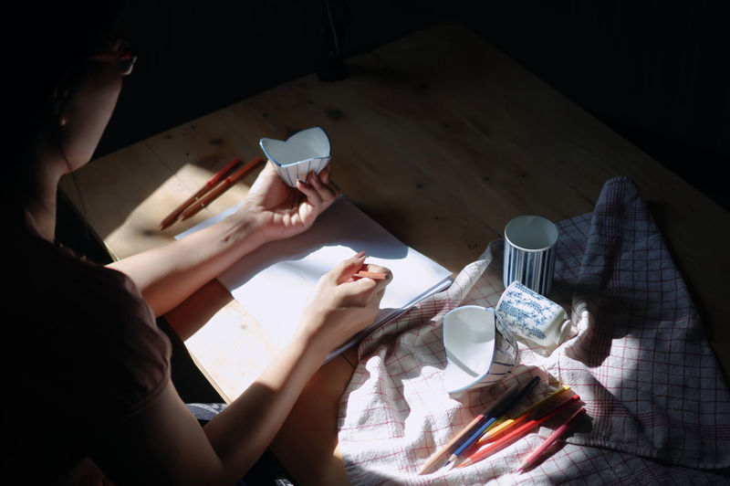 Woman painting on paper