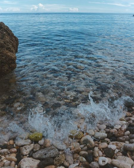 Slam them rocks Pebble Beach Water Sea Beach Wave Pebble Rock - Object Sky Horizon Over Water Close-up Shallow Low Tide Rushing Clear Shore Tide Calm Surface Stone Seascape