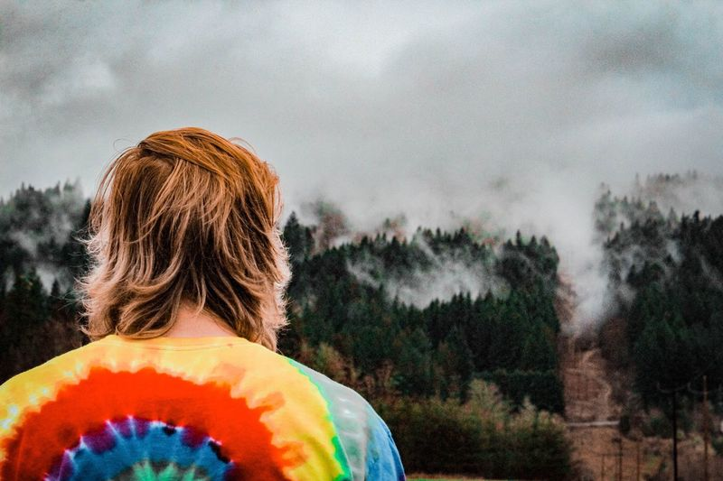 Man looking at view of trees