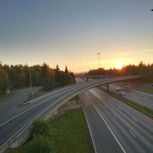 Transportation Road Sunset Tree Landscape High Angle View Copy Space Clear Sky The Way Forward Outdoors Sun Long Tranquil Scene Countryside Scenics Nature Sky Beauty In Nature Curve Tranquility Highways&Freeways Highway Motorway View Motorway HDR
