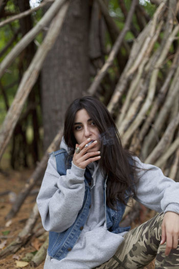 Portrait of teenage girl in forest