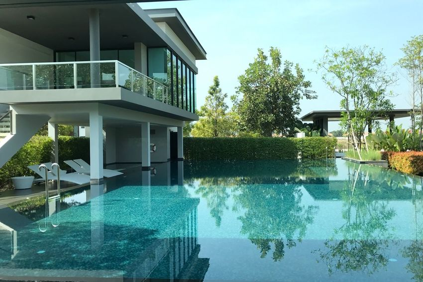 Swimming Pool Water Tree No People Architecture Luxury House Built Structure Outdoors Day Sky Infinity Pool Chiang Mai | Thailand Leisure Outdoor Photography Front View