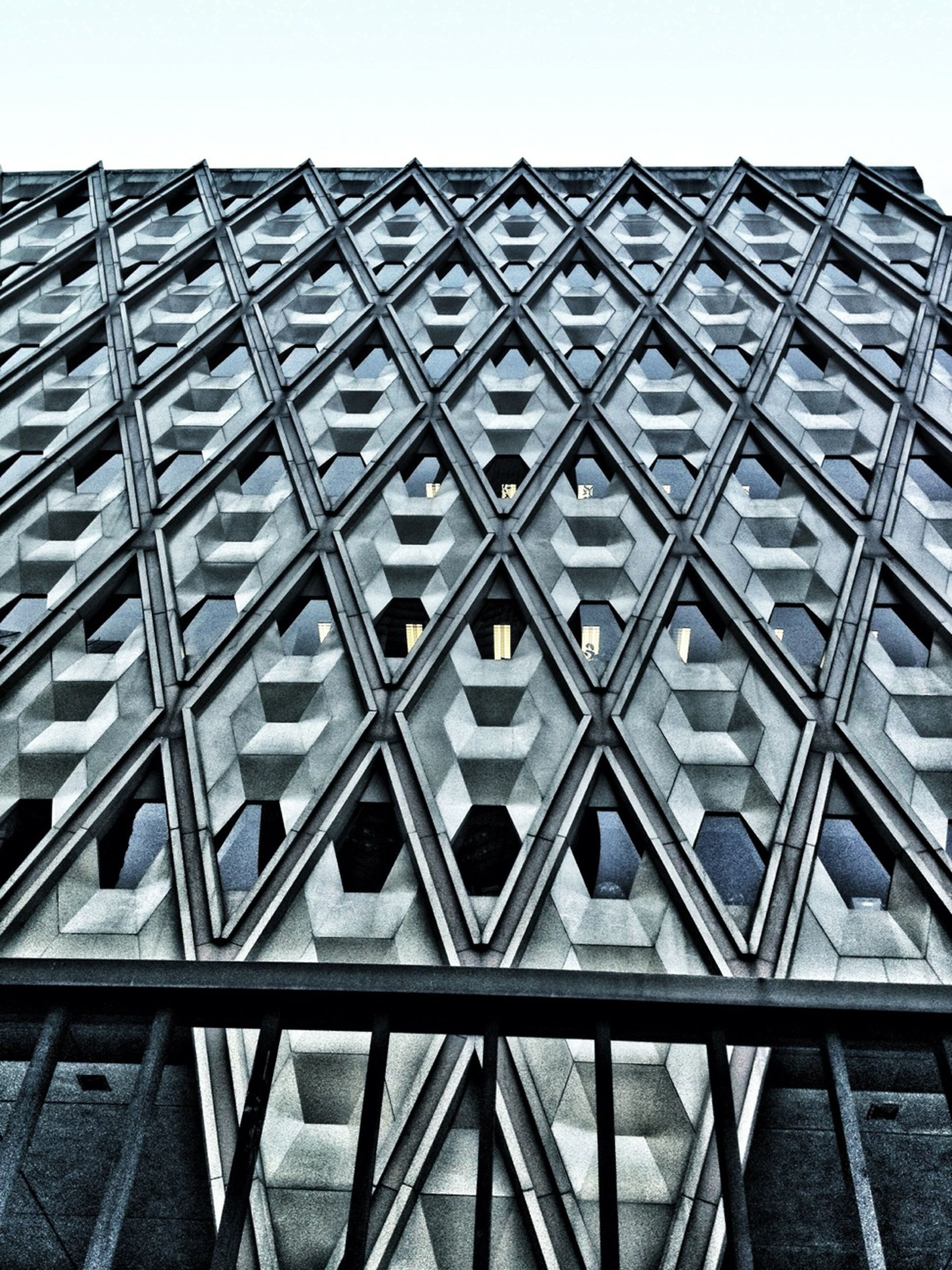 architecture, built structure, low angle view, building exterior, pattern, repetition, design, clear sky, architectural feature, modern, geometric shape, building, day, no people, sky, outdoors, in a row, metal, city, window