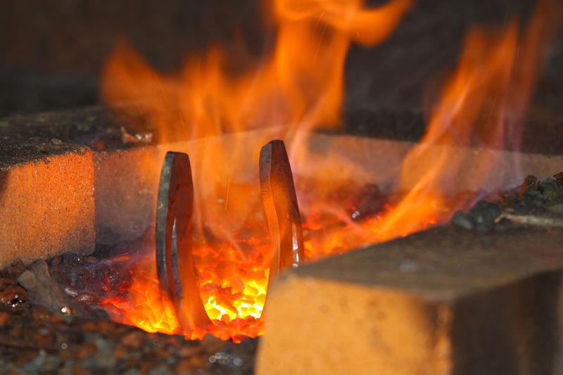 Close-up of horseshoe burning in furnace
