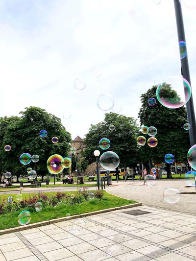 View of bubbles in park against sky